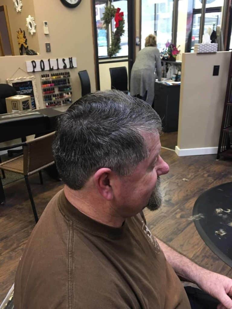 Middle aged man with hair cut. Let side photo