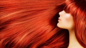 Lady with straight red hair blowing to oneside. Part of home page slideshow.