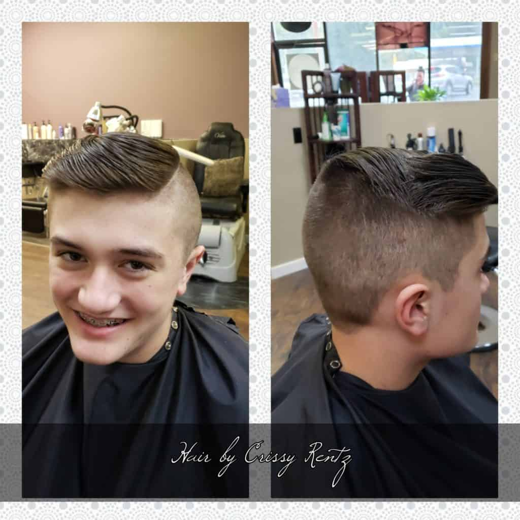 Young man hair cut. Shaved on the sides with long combed over to one side top.