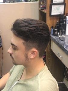 Youngman with short sides, and long combed back top.