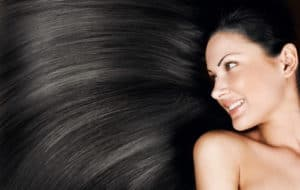 Lady with black straight hair blowing to the side . Part of home page slide show.