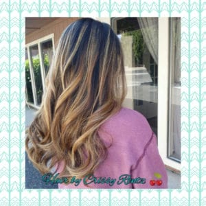 Long wavy auburn highlights